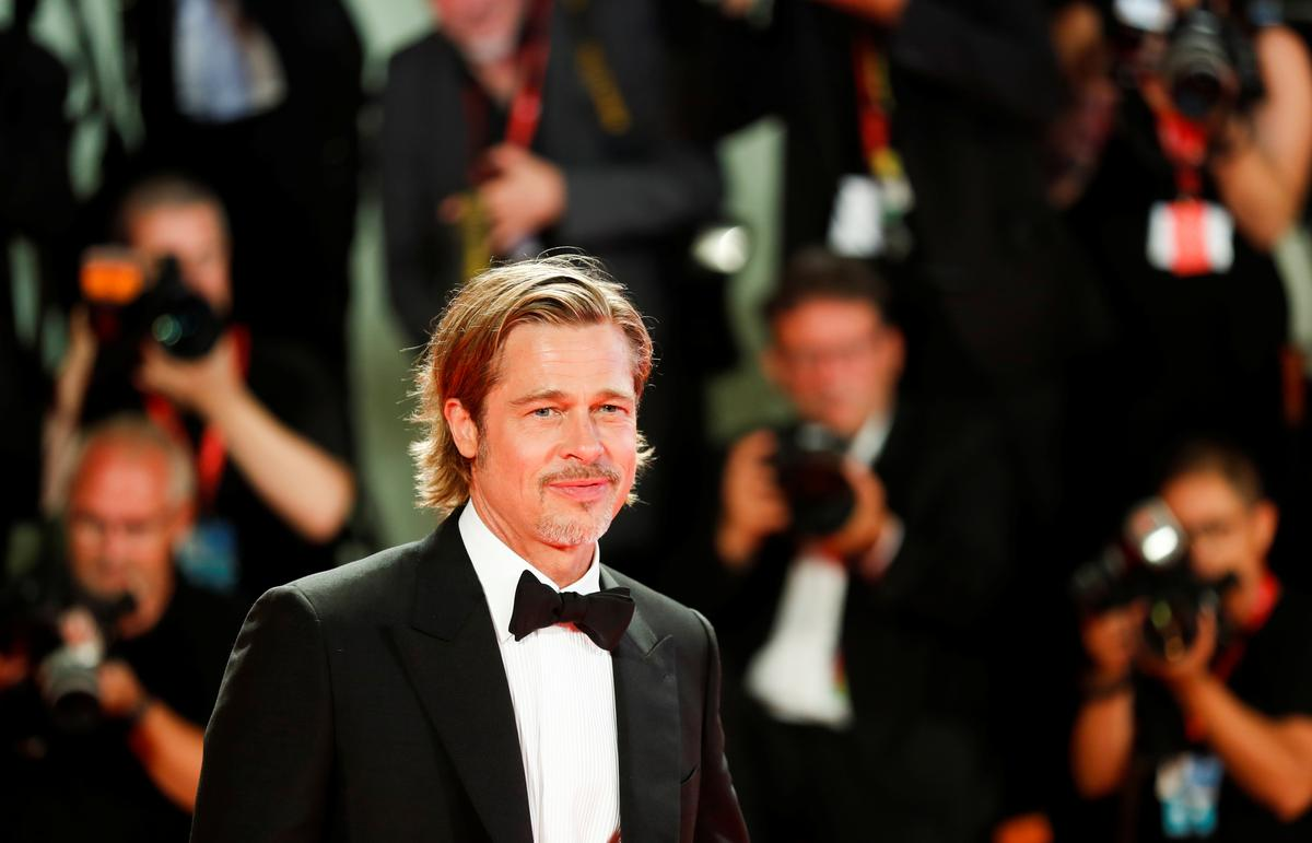 Who calls the tunes in space, Brad Pitt asks NASA astronaut