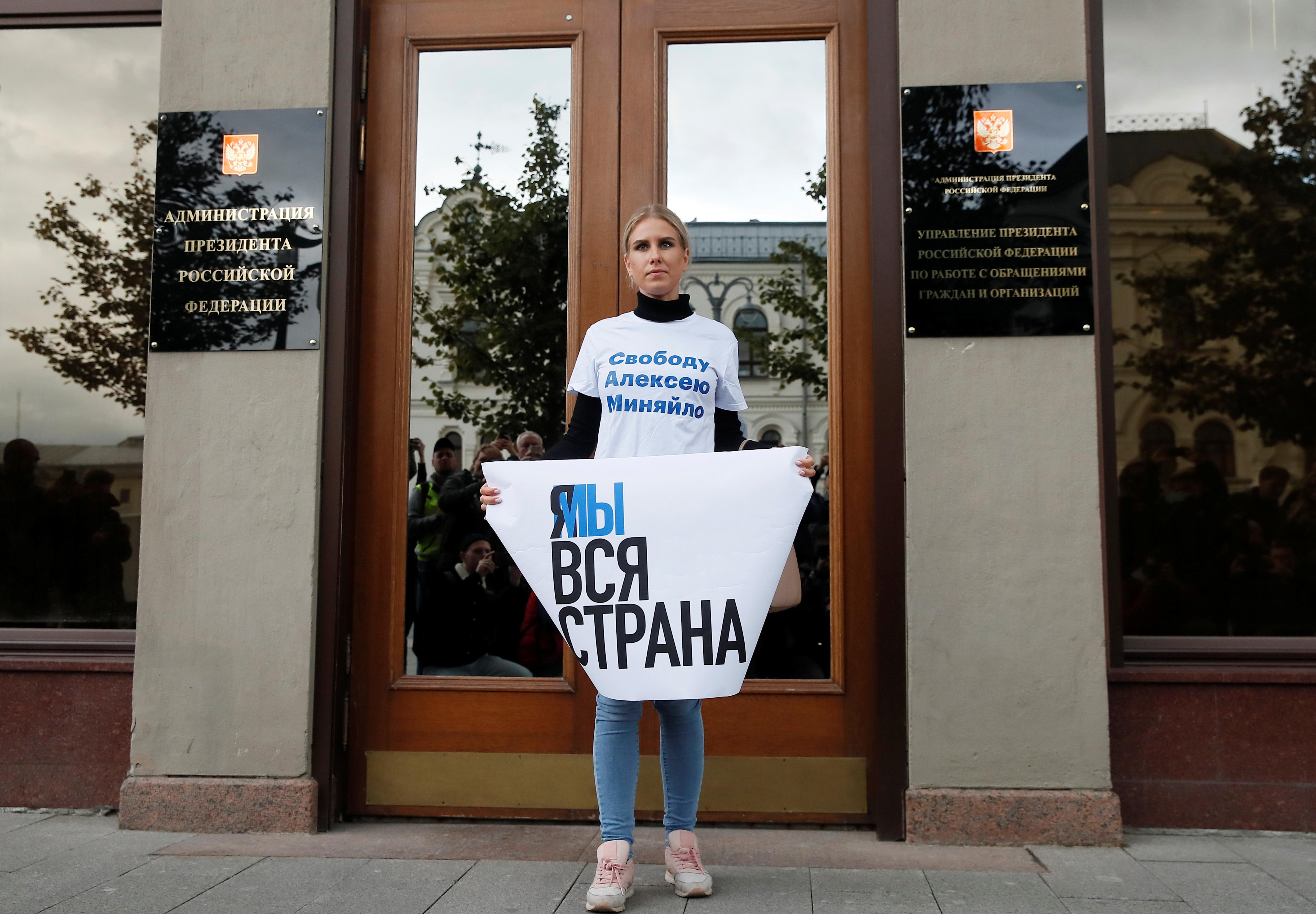Russia frees jailed protester as teachers, priests demand end to crackdown