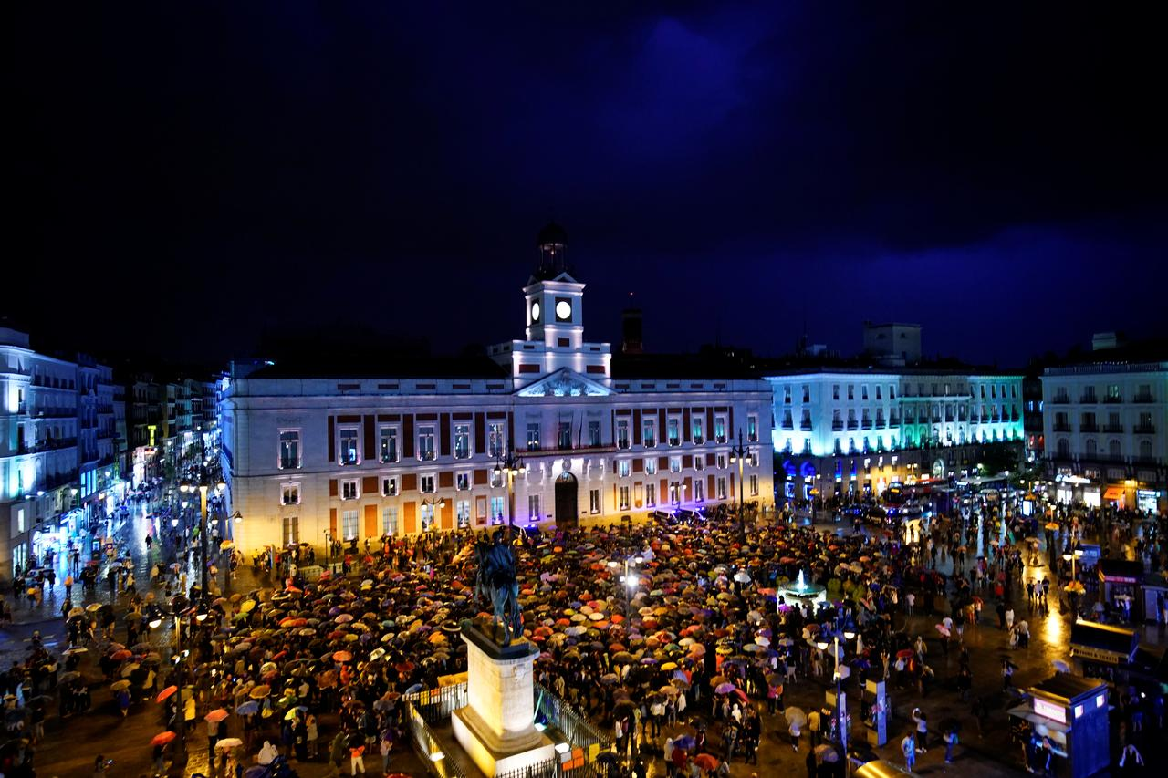 Image result for Thousands gather in Madrid to protest violence against women