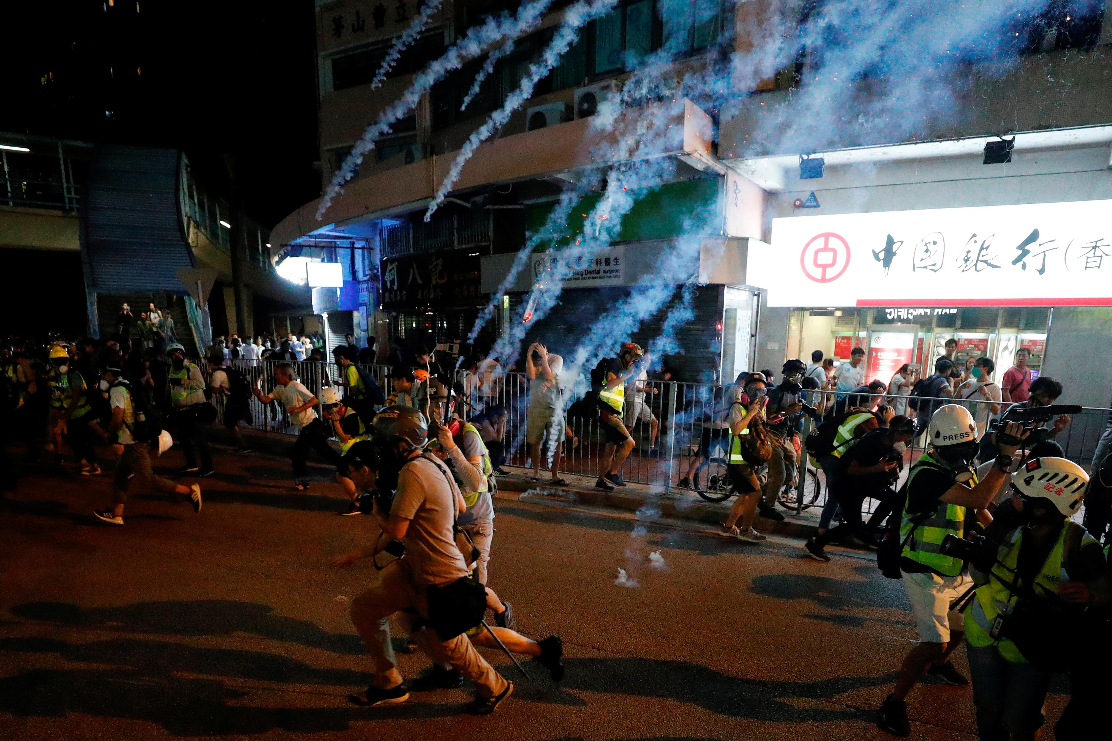 Hong Kong riot police move to curb airport protest after violent...