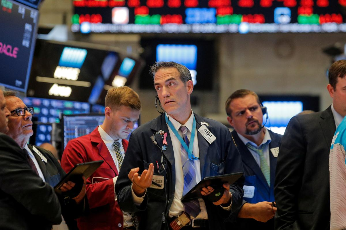 Wall Street cuts losses after upbeat manufacturing data