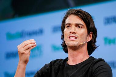 FILE PHOTO: Neumann, CEO of WeWork, speaks to guests during the TechCrunch...
