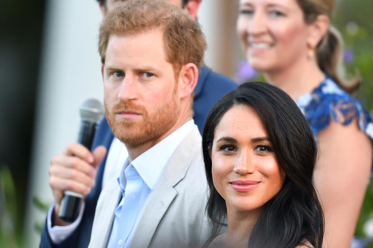 Brittanje se prins Harry en Meghan om Tutu en sy vrou te ontmoet