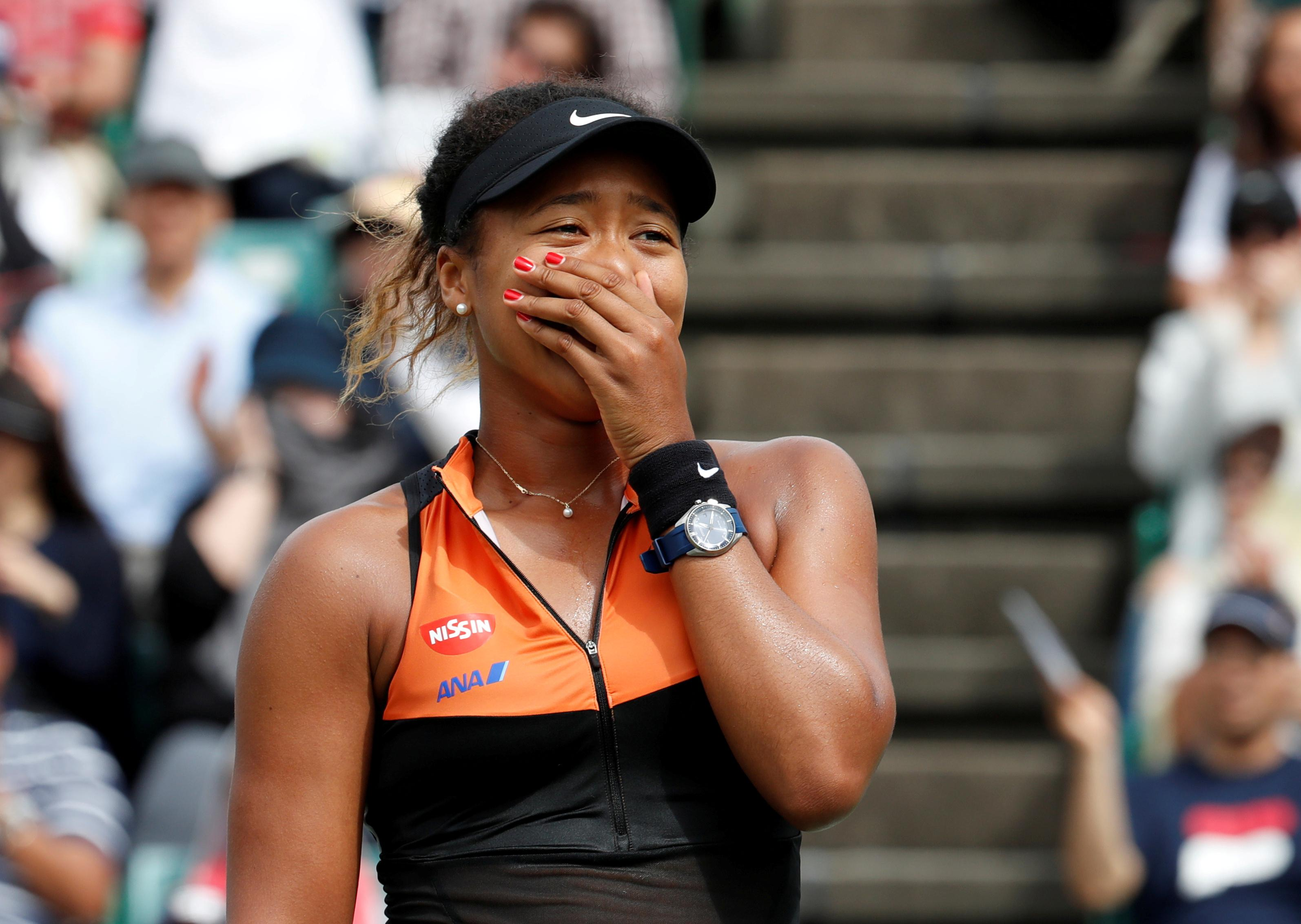 Osaka laughs off 'too sunburned' comment with plug for sponsor's...