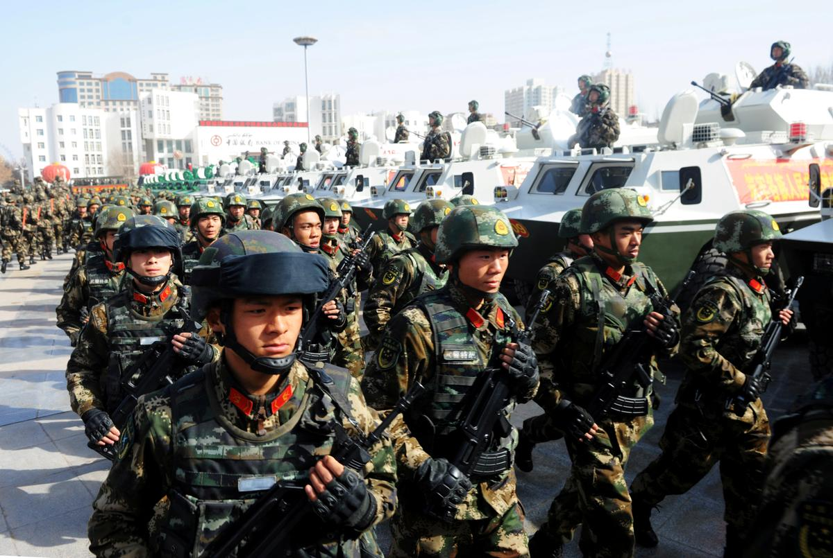 Special Report: China quietly doubles troop levels in Hong Kong, envoys say