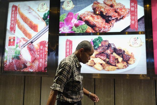 Lou Tit-Man, 73, walks in Mong Kok in Hong Kong, China September 23, 2019. REUTERS/Tyrone Siu