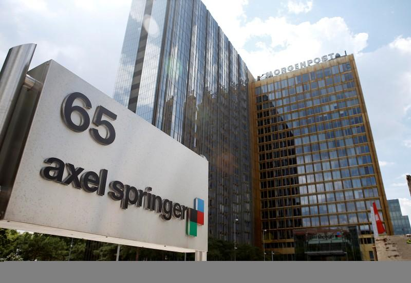 Axel Springer cuts guidance on lower revenues and restructuring costs