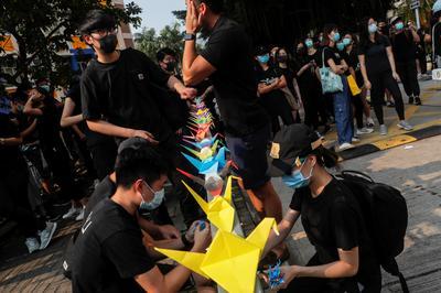 Hong Kongers denounce police shooting of teen
