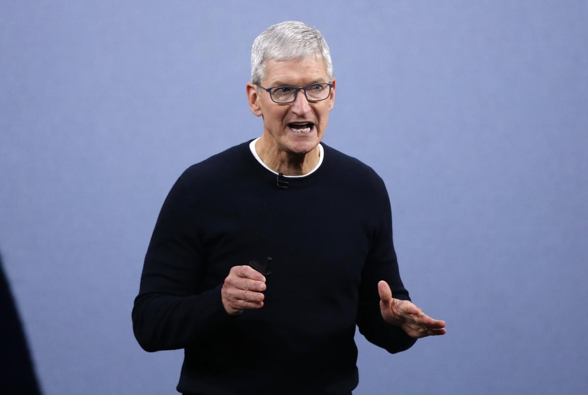 Apple chief says hopes to see trade barriers near zero