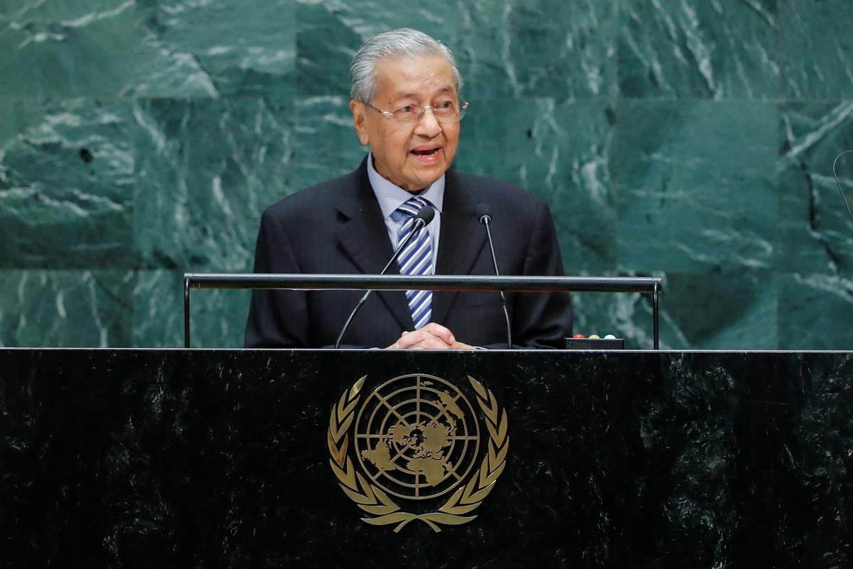 Malaysia's Mahathir says Hong Kong leader should step down: report