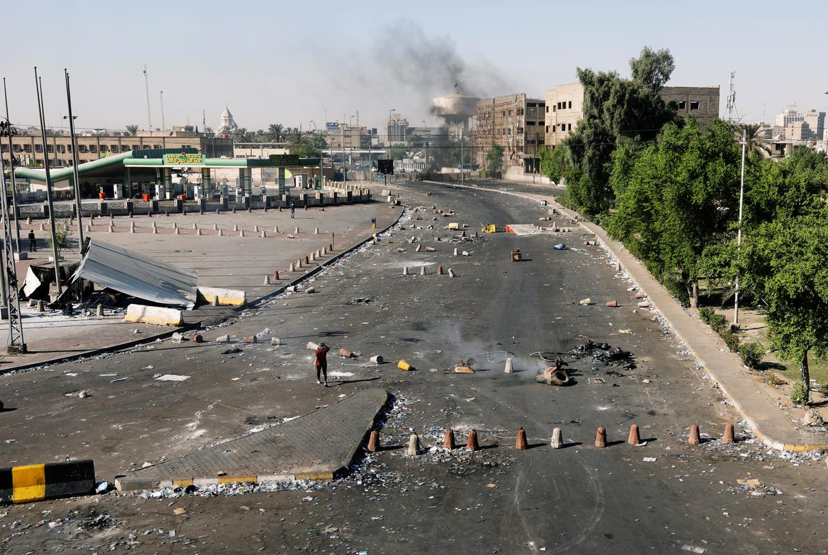 Iraqi forces fire at protesters in Baghdad after PM pledges vague reform