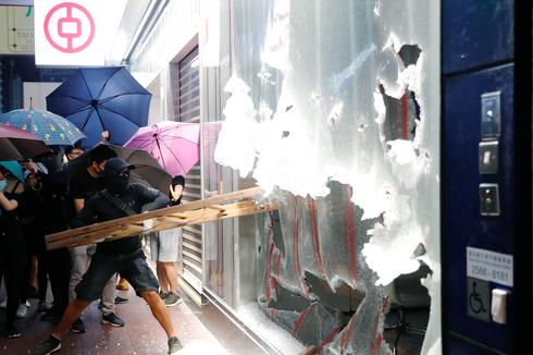 Protesters take to the streets as Hong Kong imposes emergency powers