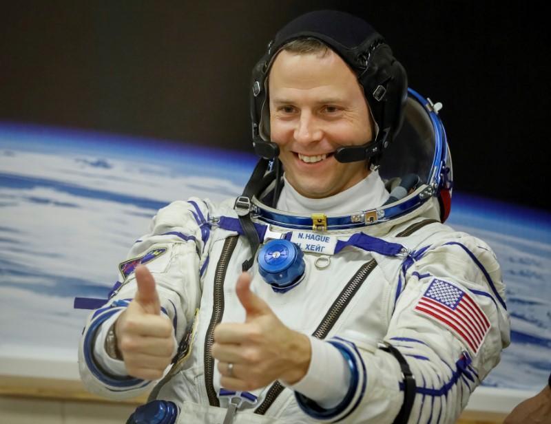 Poetin verleen die toekenning vir moed op die Amerikaanse ruimtevaarder wat raketversaking oorleef het