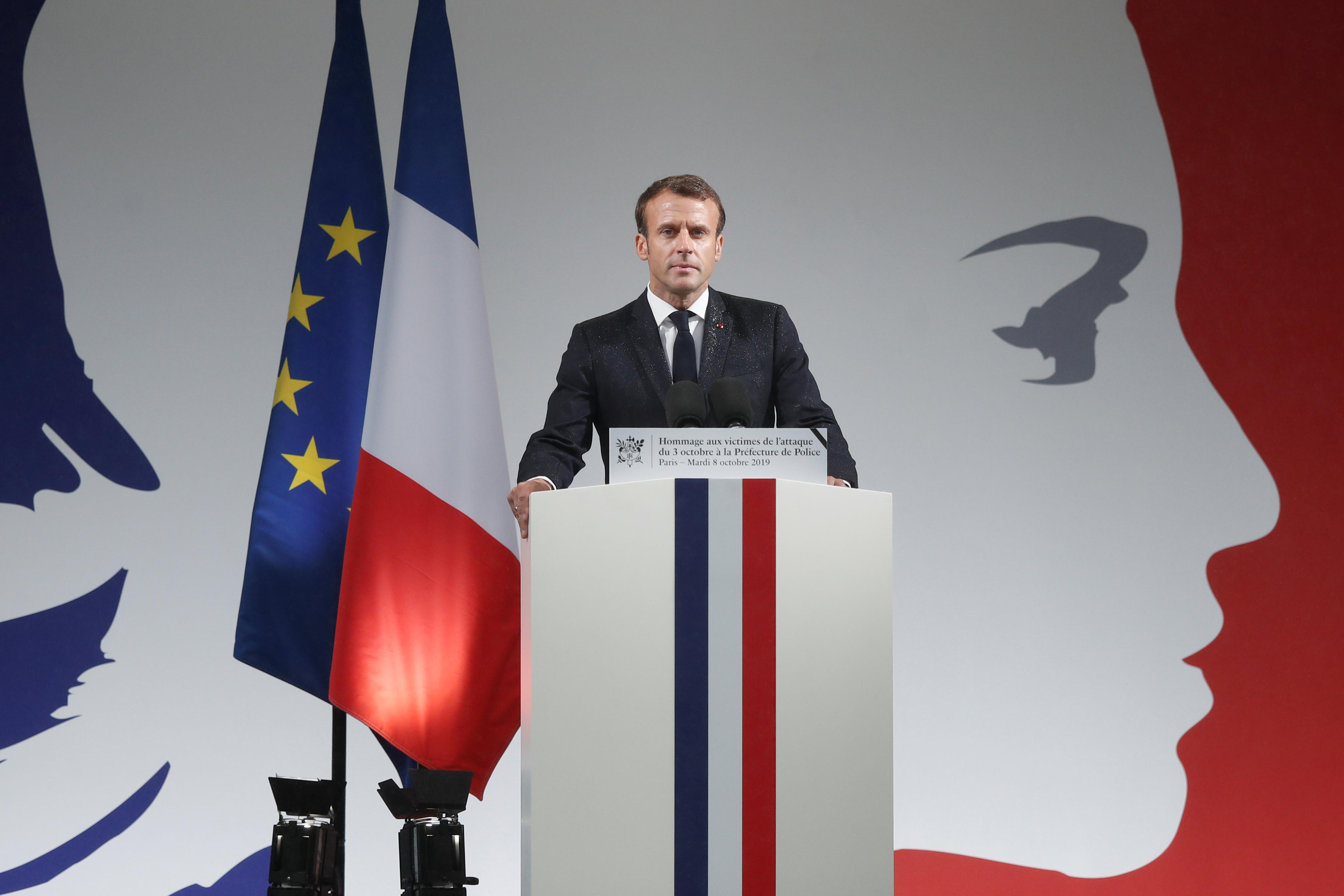 Hasil gambar untuk FILE PHOTO: French President Emmanuel Macron delivers a speech during a ceremony to honour three police officers and an administrative worker after they were killed by a 45-year-old suspected radicalised attacker last Thursday, at the Police Prefecture in Paris, France, October 8, 2019. REUTERS/Benoit Tessier