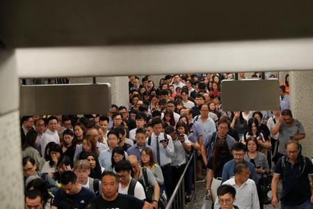 UPDATE 1-More Hong Kong protests planned as metro limps back to business
