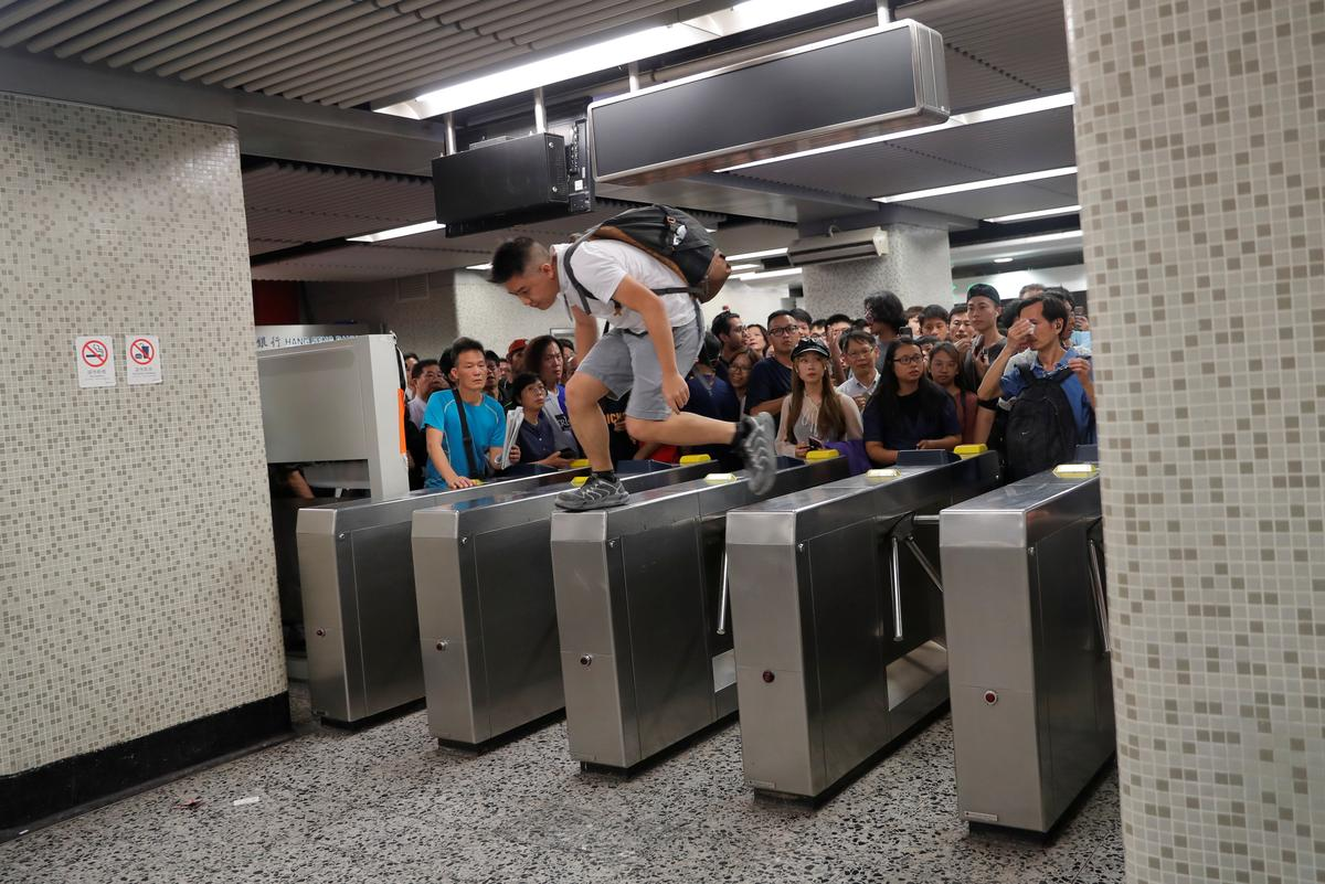 Hong Kong's metro, legislature open; more protests planned for weekend