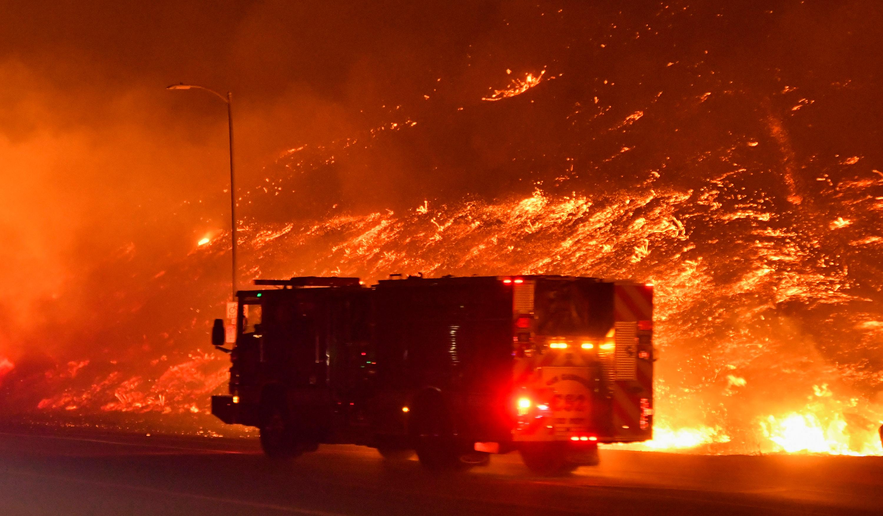 One man dies as wind-driven Los Angeles wildfire forces 100,000 to...