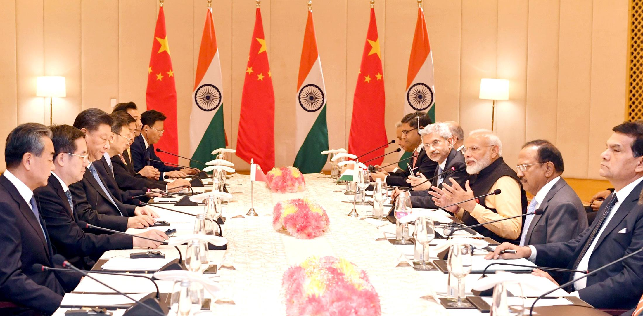 China, locked in trade war with U.S., agrees to tackle India's...