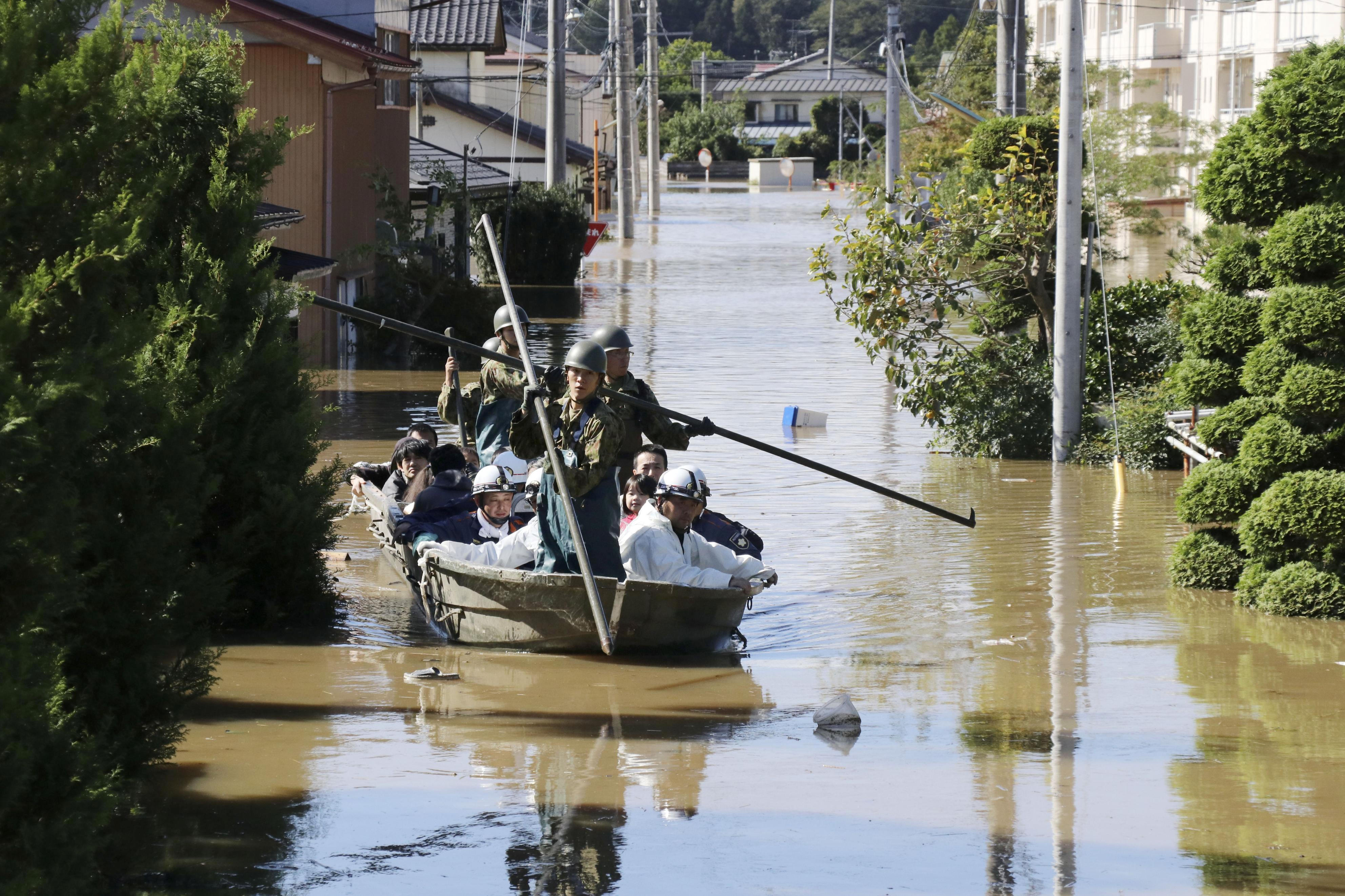 Japan sends in troops after deadly typhoon floods towns, threatens...