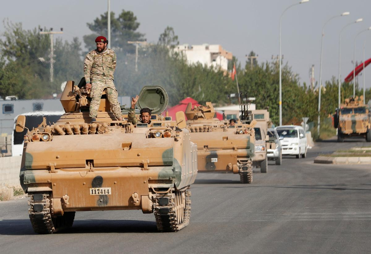 Syrian army to deploy along Turkish border in deal with Kurdish-led...