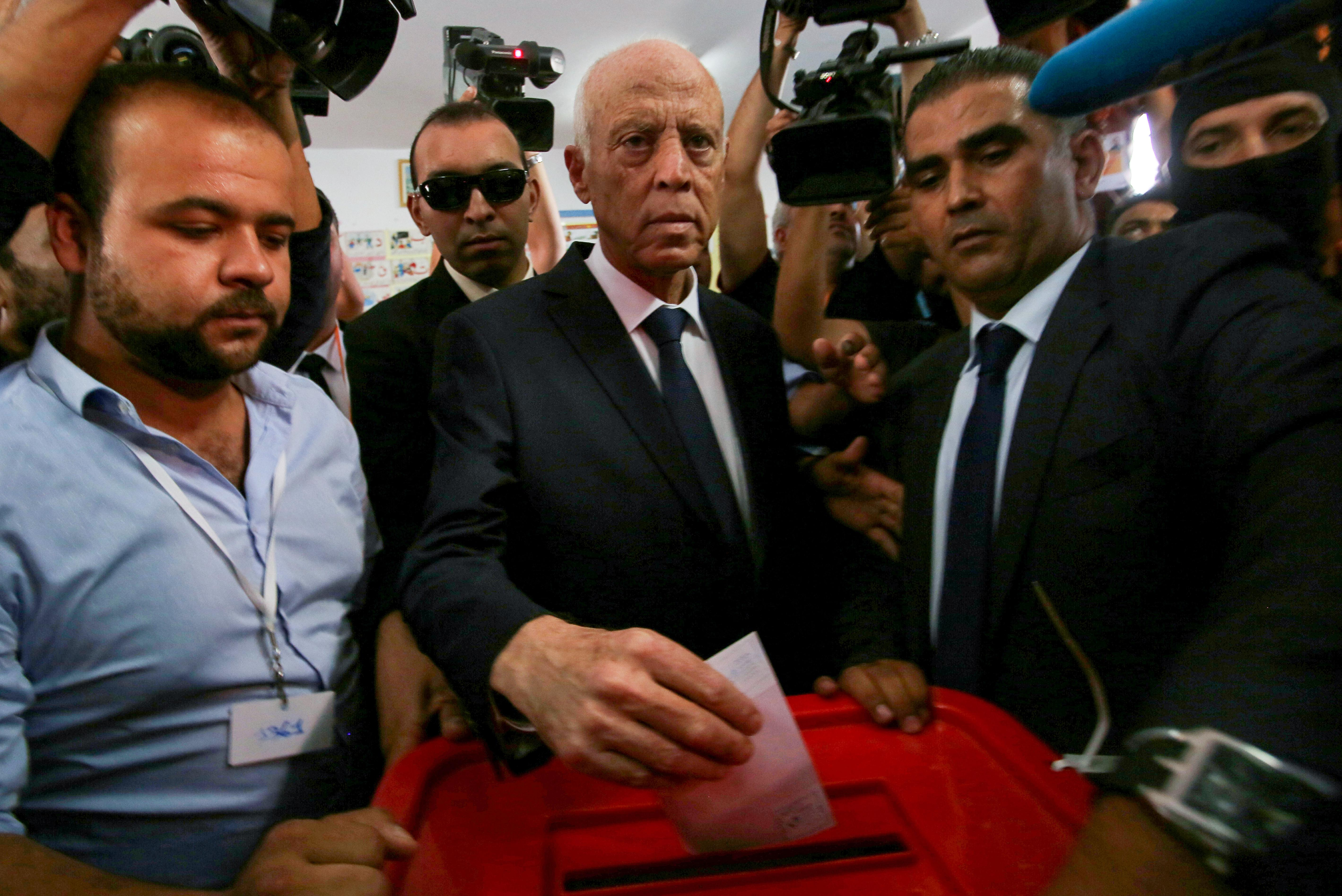 Supporters of Tunisia's Saied celebrate his projected presidential win