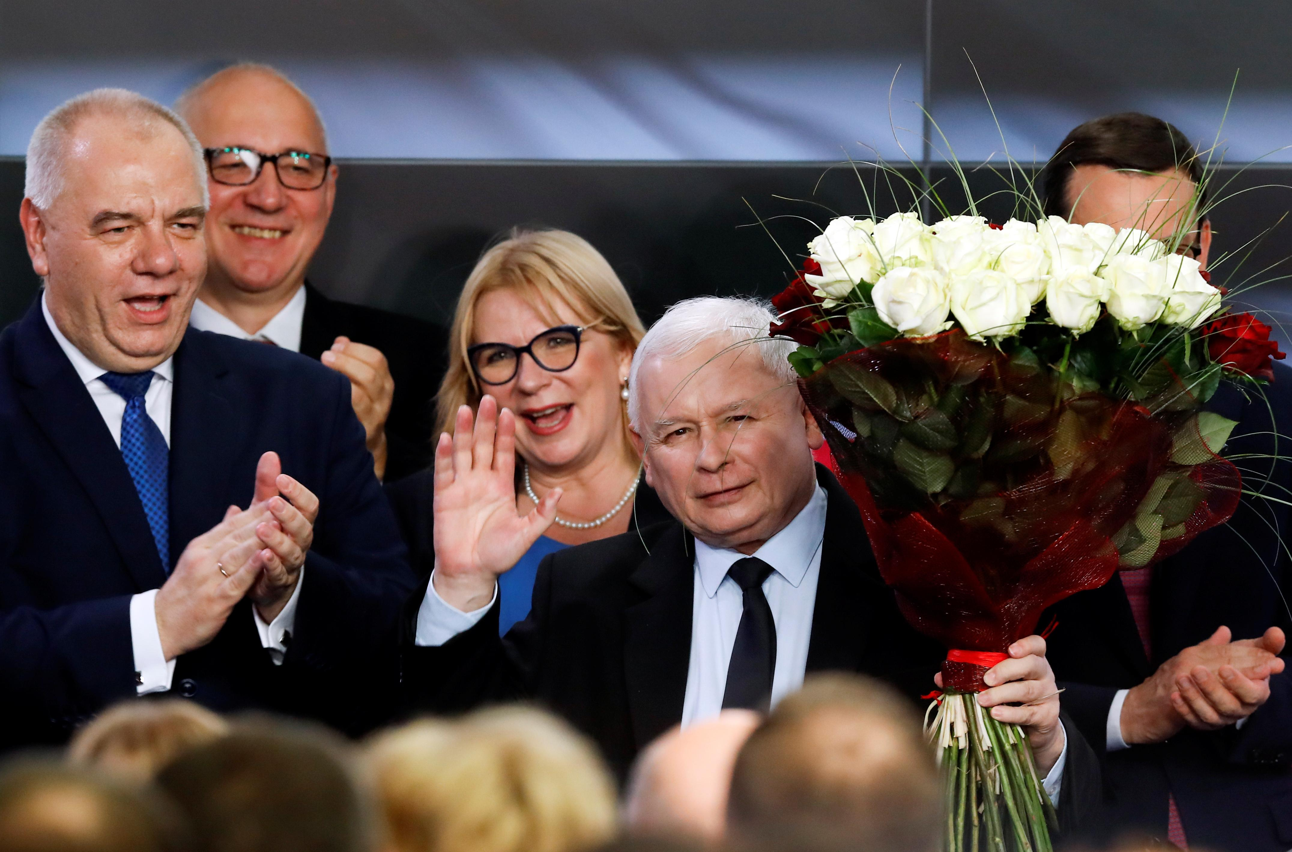 Poland's nationalists win majority in parliament again, eye court...