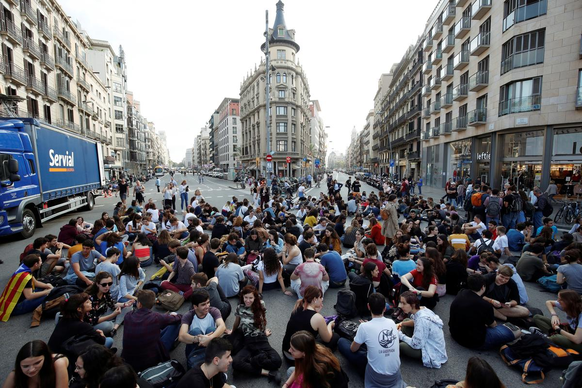 Spain jails Catalan separatist leaders, protesters take to streets