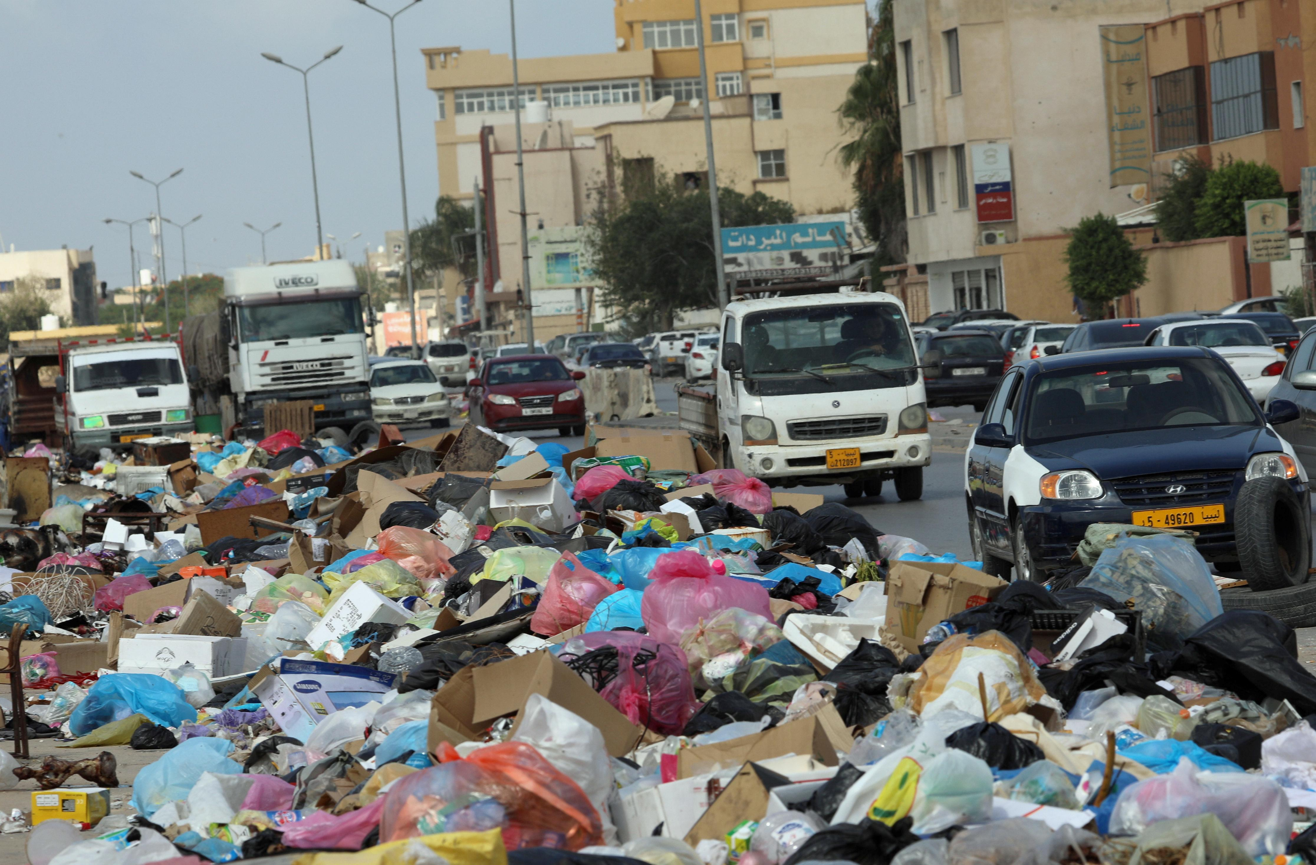 Libyan conflict leaves rubbish mounds smoldering in Tripoli's streets