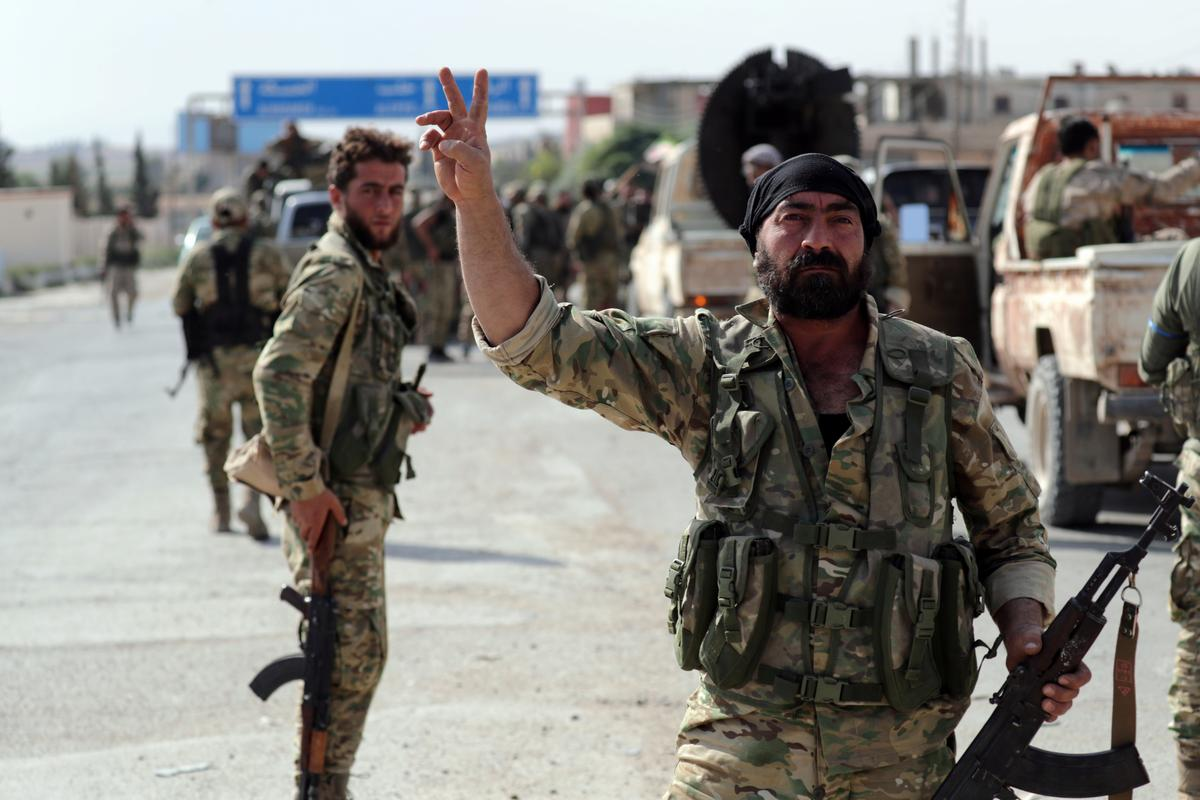 Putin aide: Turkish operation 'not exactly' compatible with Syria's...