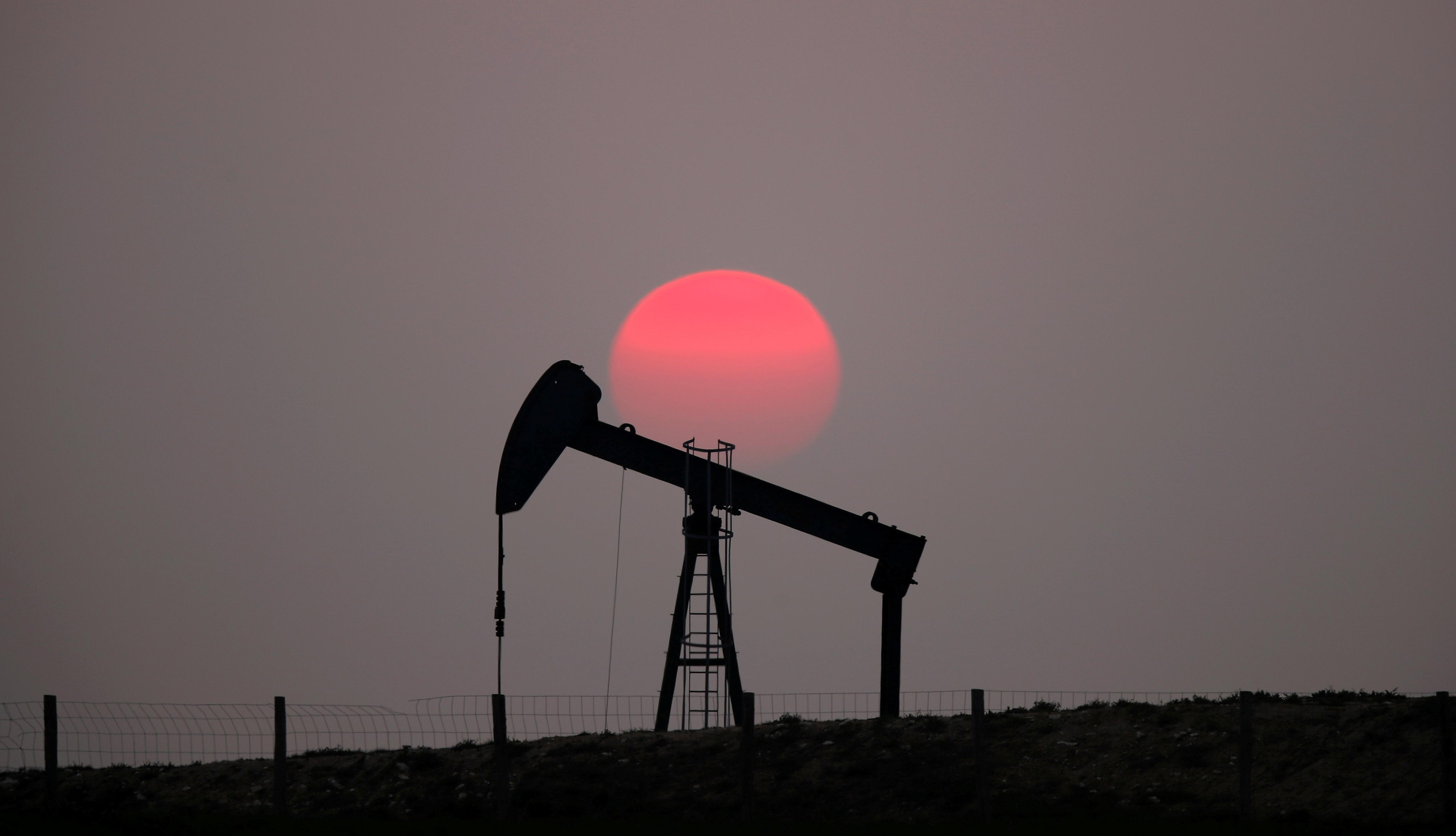 Oil falls on weaker economic growth forecasts and swelling US crude...