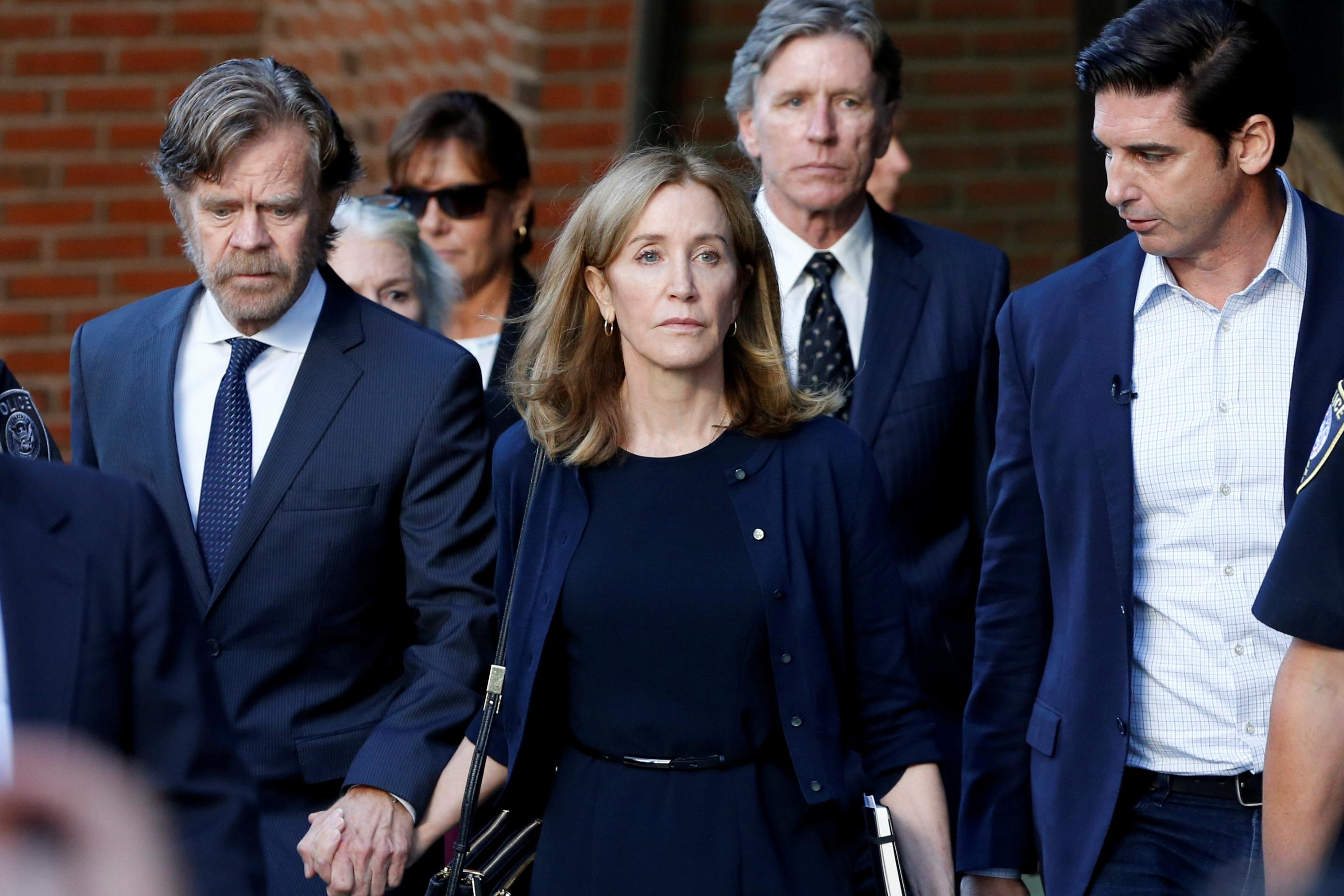 Actress Felicity Huffman reports to prison for part in U.S. college...