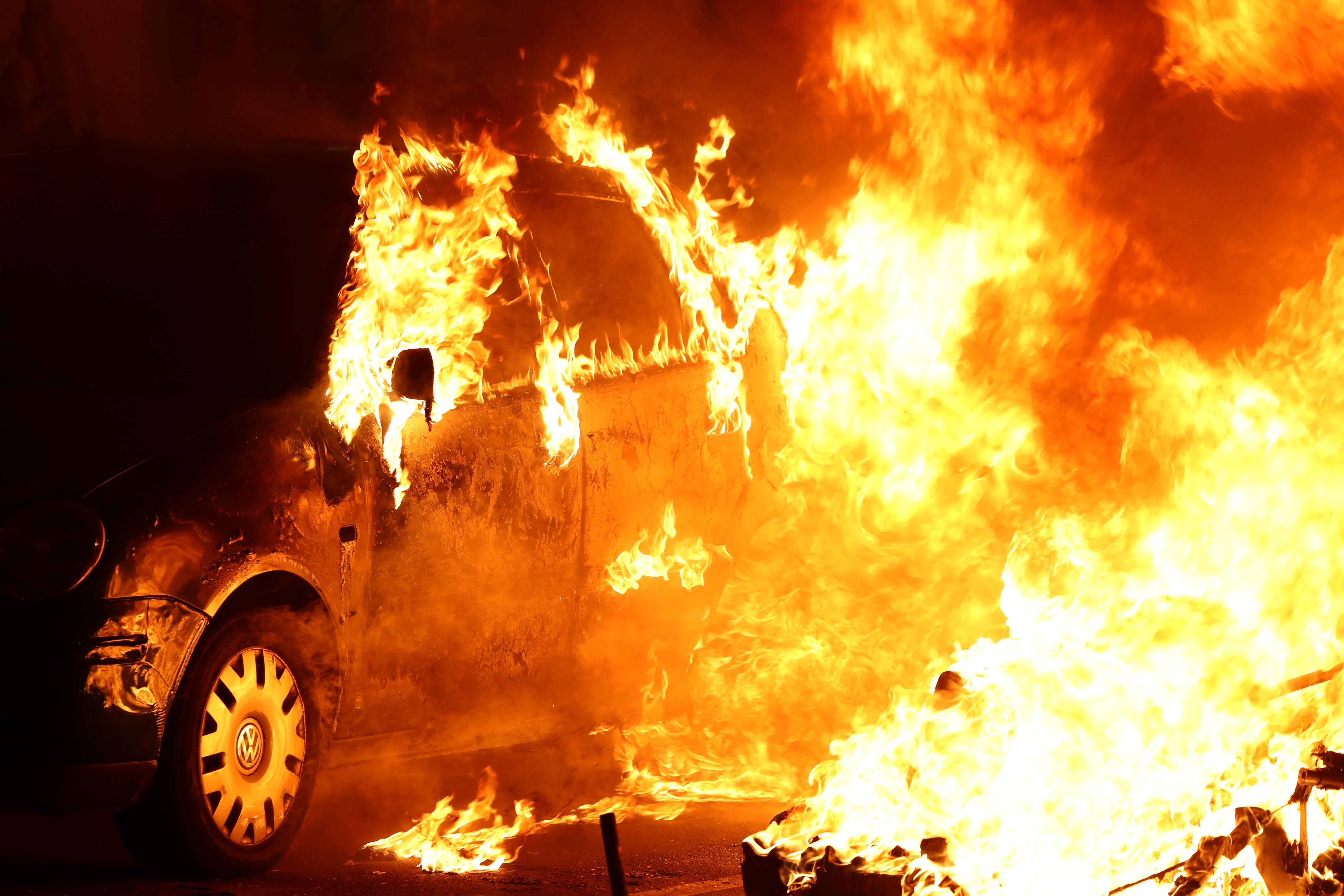 Cars burn in Barcelona as protesters ignore calls for calm