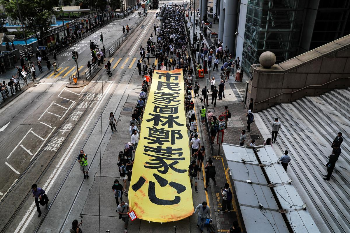Hong Kong protesters vow to hit the streets in major 'illegal' march
