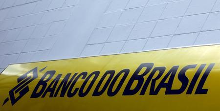 UPDATE 1-Banco do Brasil shares up over 2% after raising $1.39 bln