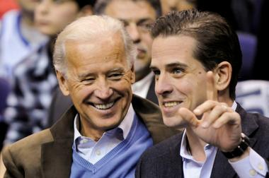 FILE PHOTO: Former U.S. Vice President Biden and his son Hunter attend an...