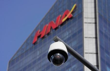 China's indebted HNA group names chairman's son as president: Caixin