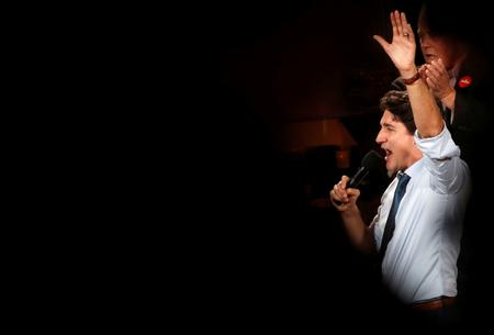 UPDATE 1-Canada votes as Trudeau, his 'sunny ways' dimmed by scandals, seeks to retain power