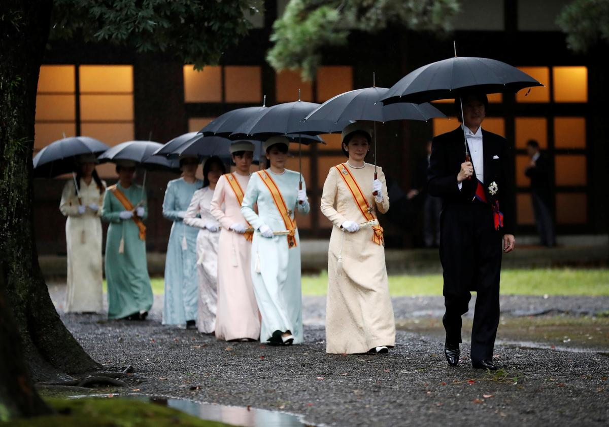 Japanese emperor begins enthronement ritual amid downpour