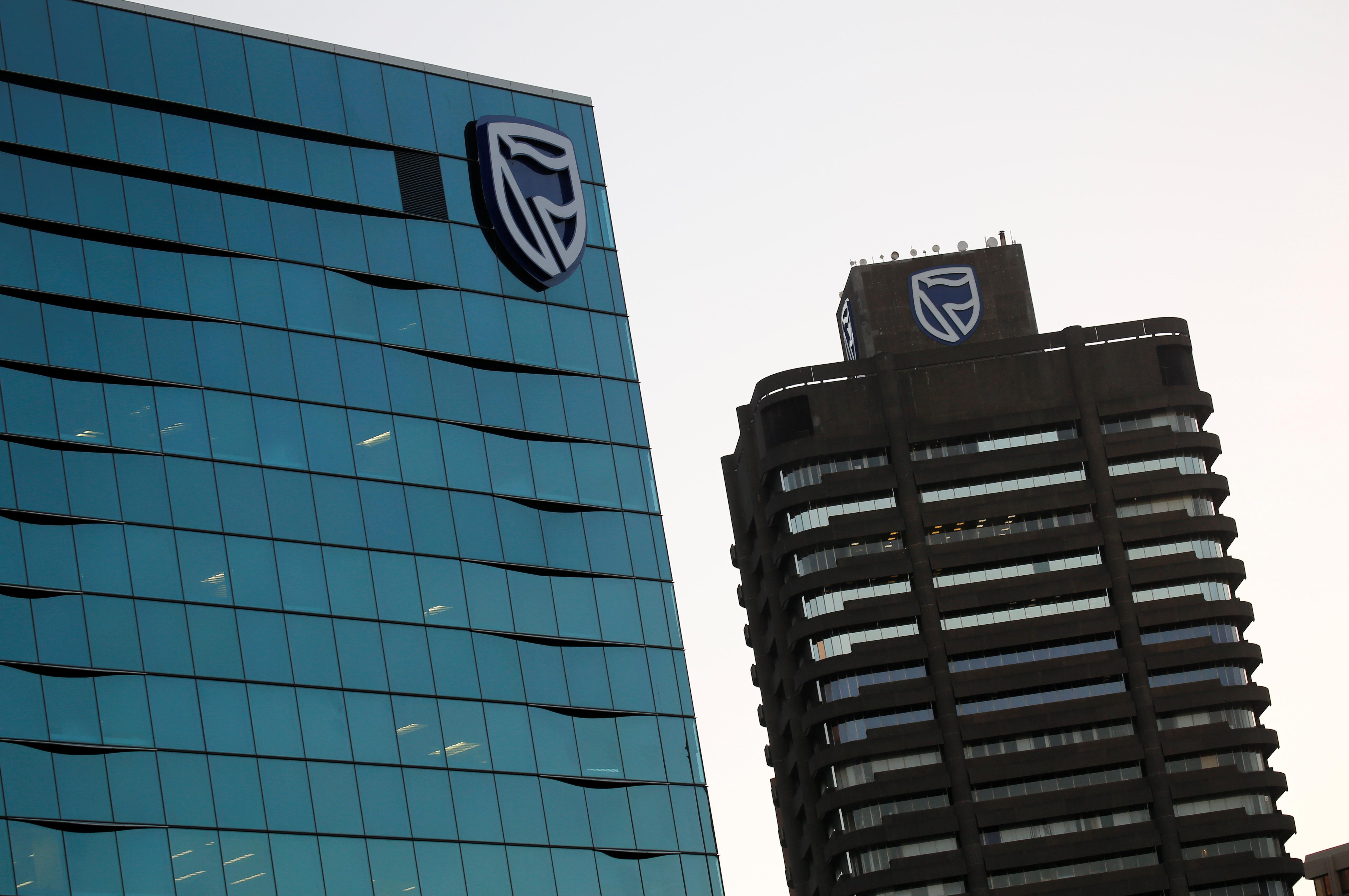 South Africa's Standard Bank cuts value of ICBCS stake as market...