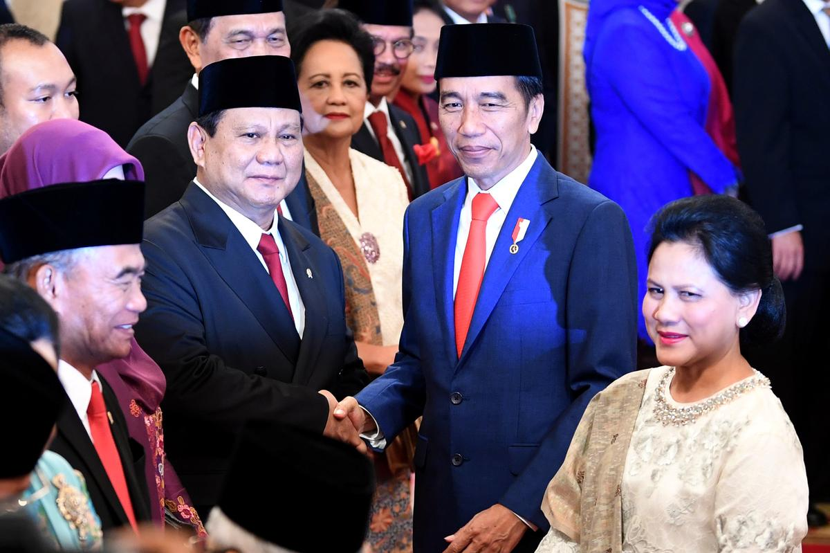 Widodo's gamble: Indonesia president includes fierce rival in cabinet