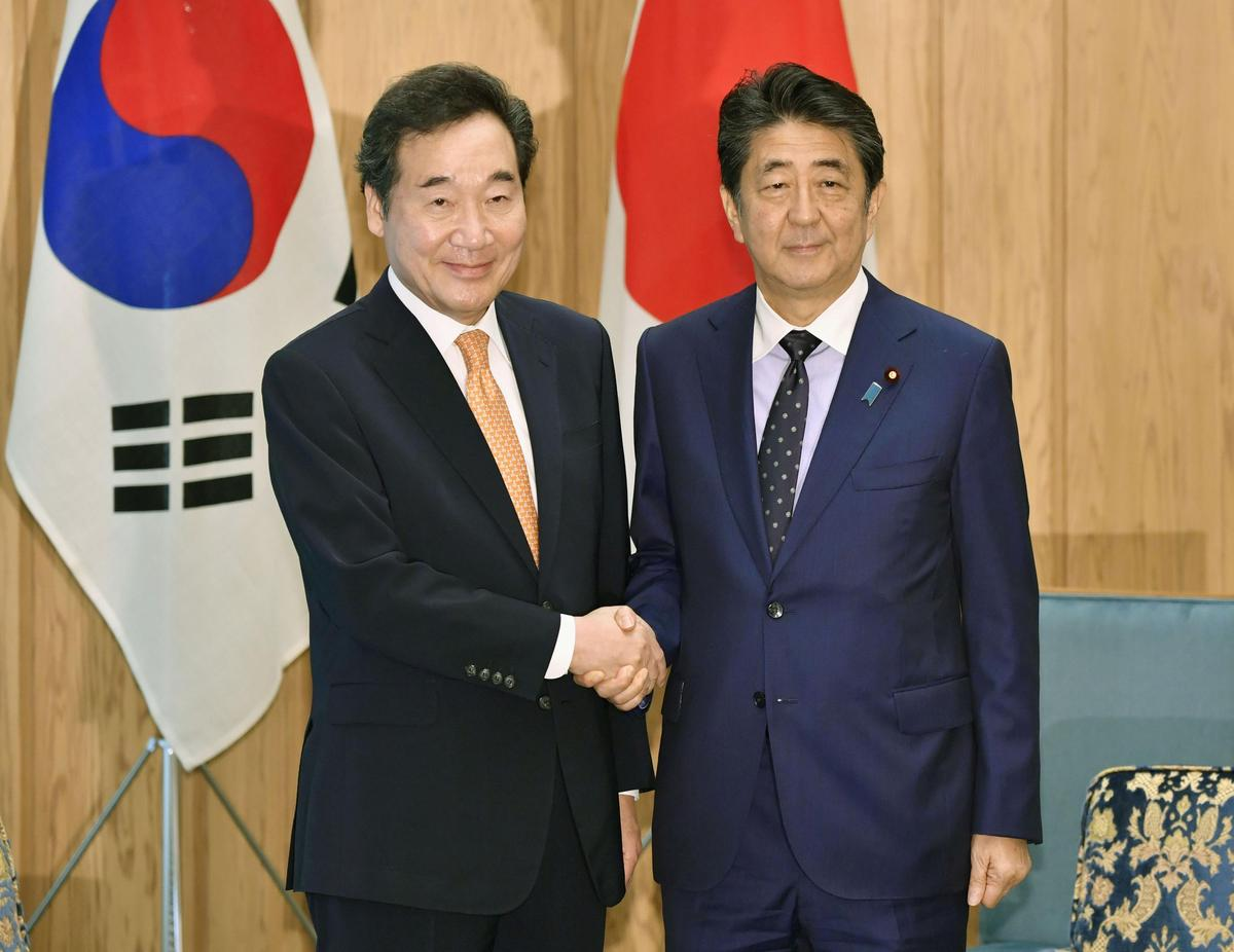 Japan's Abe renews call on South Korea to keep promises to mend ties