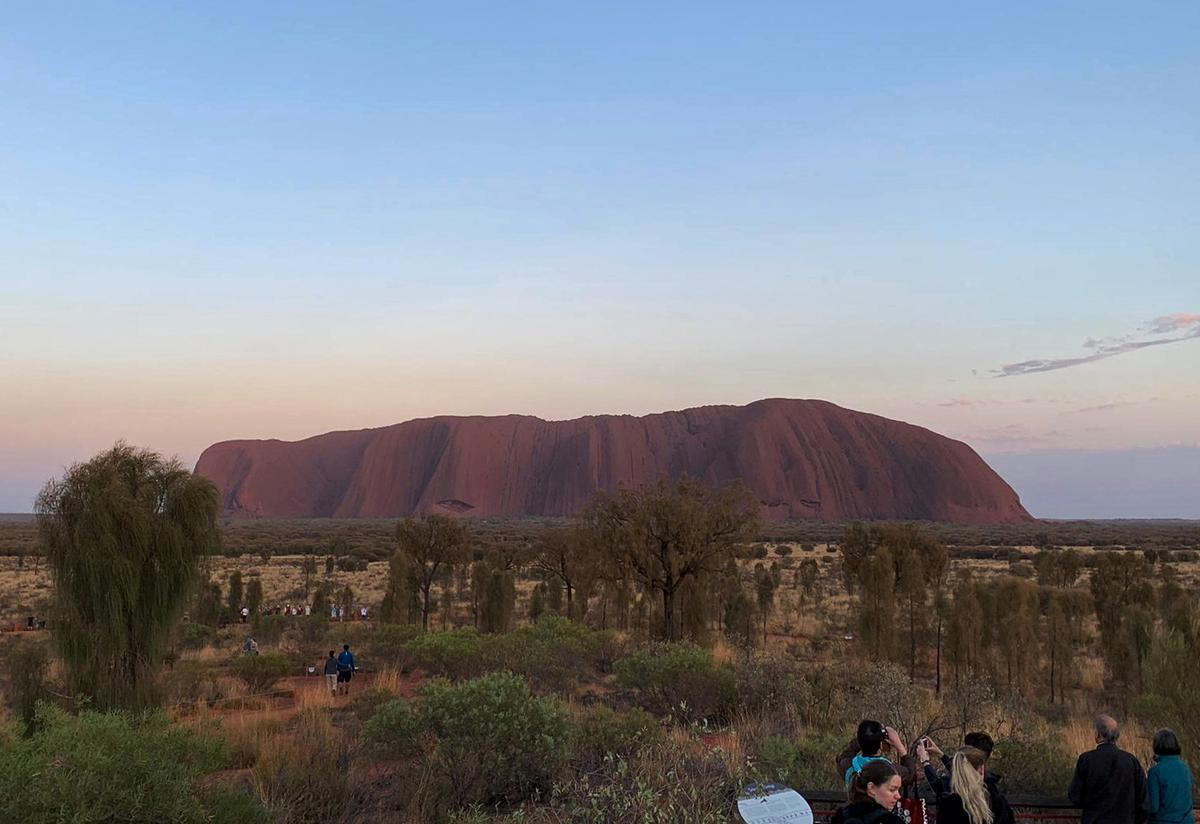 Tourists line up to scale Australia's Uluru hours ahead of climb ban