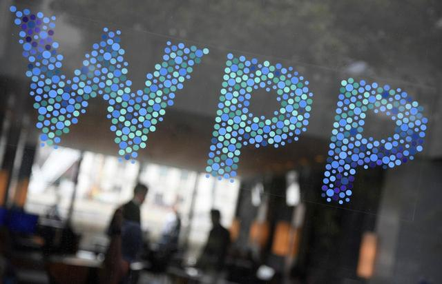 FILE PHOTO: Branding signage is seen for WPP Group at their offices in London, Britain, July 17, 2019.  REUTERS/Toby Melville
