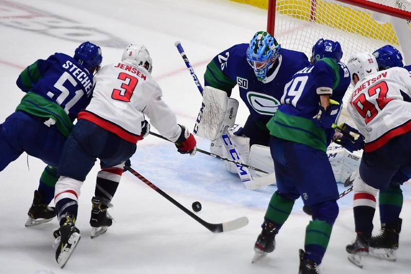 NHL roundup: Caps rally from 4 down, sink Canucks in SO