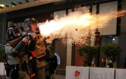 Protesters hurl petrol bombs after police fire tear gas in Hong Kong