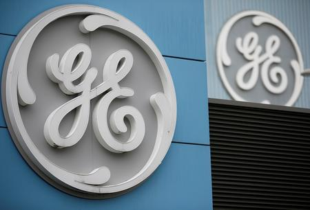 GE posts loss; raises cash forecast, beats on adjusted EPS