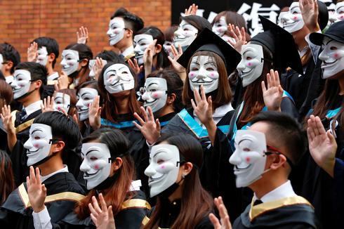 Hong Kong students pose in masks at graduation ceremony