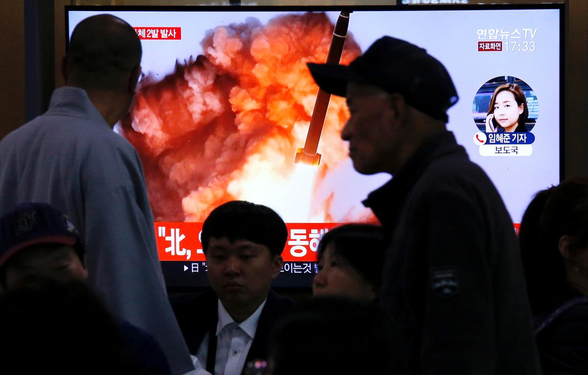 North Korea launches two suspected missiles after warnings to...