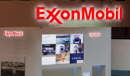 WRAPUP-Exxon, Chevron earnings fall on lower oil and gas prices