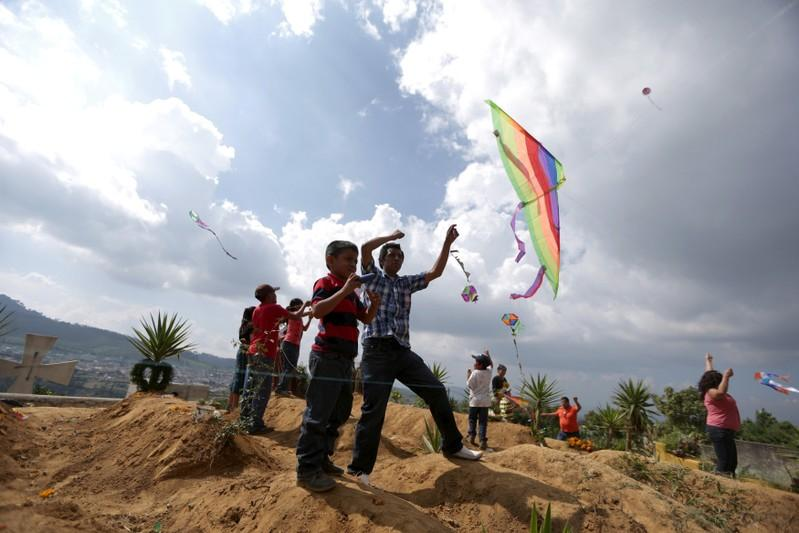 Guatemalans remember their dead with giant kites as Day of the Dead begins